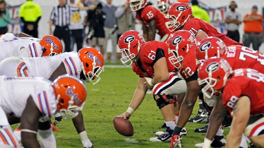 FILE - In this Oct. 27, 2012, file photo, The Florida defense, left, lines up for a play against Georgia during the second half of an NCAA college football game in Jacksonville, Fla. Georgia and Florida, teams that began the year with championship aspirations, have been ravaged by injuries and enter their annual Cocktail Party game at Jacksonville staring at the final gasp to make something of their disappointing seasons. (AP Photo/John Raoux, File)