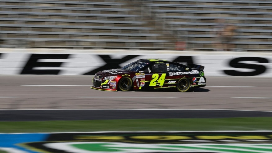 Driver Jeff Gordon (24) speeds down the strait away practice for Sunday's NASCAR Sprint Cup series auto race at the Texas Motor Speedway in Fort Worth, Texas, Friday, Nov. 1, 2013.  With only three races left in the NASCAR championship chase, and third in the standings, Gordon needs one of those good finishes at the track, where he has 11 top-10 finishes, but also two last-place finishes. (AP Photo/LM Otero)