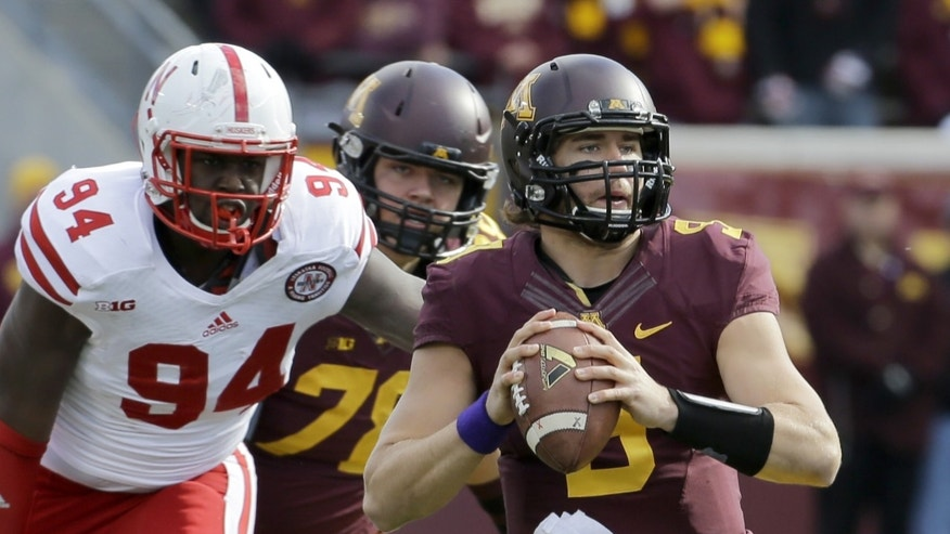 Minnesota quarterback Philip Nelson (9) drops back for a pass during the second quarter of an NCAA college football game against Nebraska in Minneapolis, Saturday, Oct. 26, 2013. Minnesota won 34-23. (AP Photo/Ann Heisenfelt)