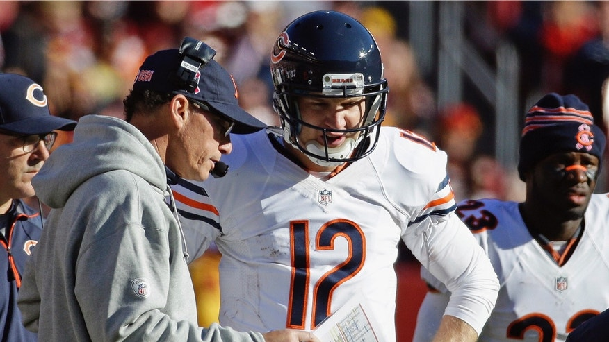 FILE - In this Oct. 20, 2013 file photo, Chicago Bears quarterback Josh McCown talks with head coach Marc Trestman during an NFL football game against the Washington Redskins in Landover, Md. During the game, McCown led the Bears to a 24-point second half when pressed into service to replace injured Jay Cutler, but he had no preparation time in that one. Now, after a couple weeks to get ready to face the Green Bay Packers on Monday, Nov. 4, McCown expects to be ready to produce against a defense that has always given Cutler fits. (AP Photo/Alex Brandon File)