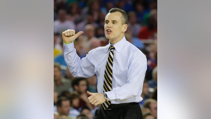 FILE - In this March 29, 2013 file photo, Florida head coach Billy Donovan gestures during the first half of a regional semifinal game in the NCAA college basketball tournament, Arlington, Texas. No. 10 Florida will start the season with three players suspended. Donovan says big men Dorian Finney-Smith and Damontre Harris have been suspended indefinitely, joining point guard Scottie Wilbekin on the sideline. (AP Photo/Tony Gutierrez, File)