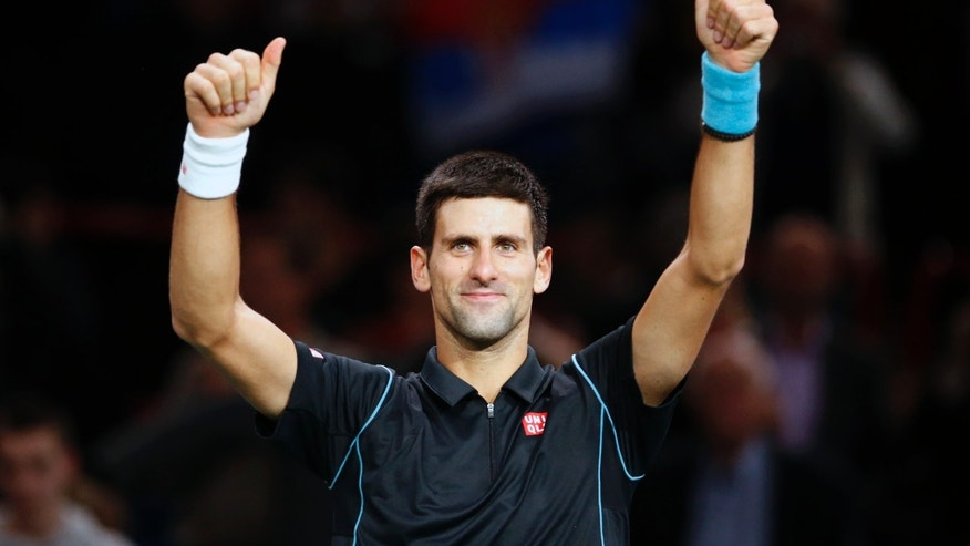 Novak Djokovic of Serbia celebrates after winning against John Isner of the USA during their round of eight match, at the Paris Masters tennis at Bercy Arena in Paris, France, Thursday, Oct. 31, 2013. (AP Photo/Francois Mori)