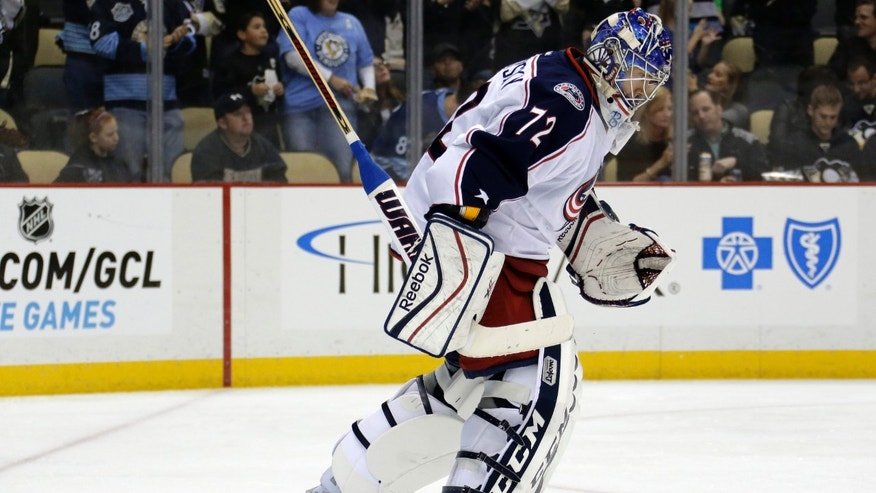 Columbus Blue Jackets goalie Sergei Bobrovsky skates to the bench and is replaced by Curtis McElhinney after allowing his third goal of the NHL hockey game, in the second period against the Pittsburgh Penguins in Pittsburgh on Friday, Nov. 1, 2013. (AP Photo/Gene J. Puskar)