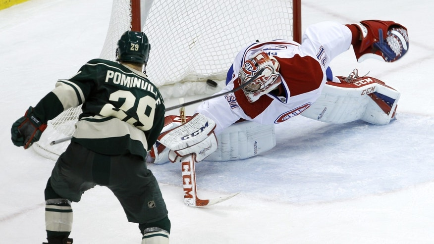 Minnesota Wild right wing Jason Pominville (29) scores the game-winning goal past Montreal Canadiens goalie Carey Price (31) during the third period of an NHL hockey game in St. Paul, Minn., Friday, Nov. 1, 2013. The Wild beat the Canadiens 4-3. (AP Photo/Ann Heisenfelt)