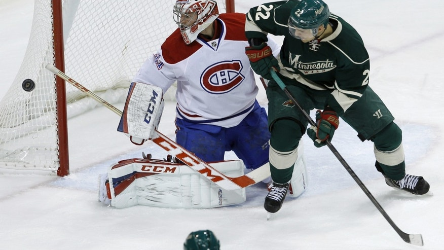 Minnesota Wild right wing Nino Niederreiter (22), of Switzerland, watches as Montreal Canadiens goalie Carey Price (31) deflects a shot during the first period of an NHL hockey game in St. Paul, Minn., Friday, Nov. 1, 2013. (AP Photo/Ann Heisenfelt)