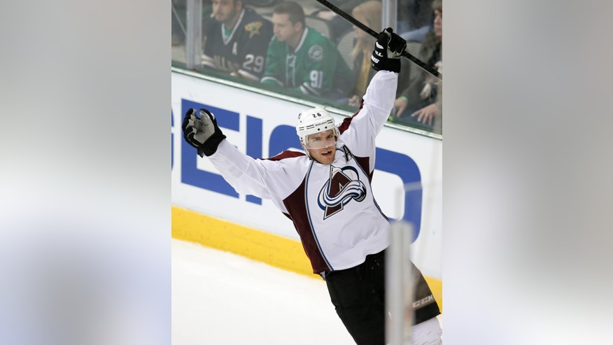 Colorado Avalanche center Paul Stastny celebrates his goal against the Dallas Stars in overtime of an NHL hockey game, Friday, Nov. 1, 2013, in Dallas. Stastny also scored in the first period of the 3-2 Avalanche win. (AP Photo/Tony Gutierrez)