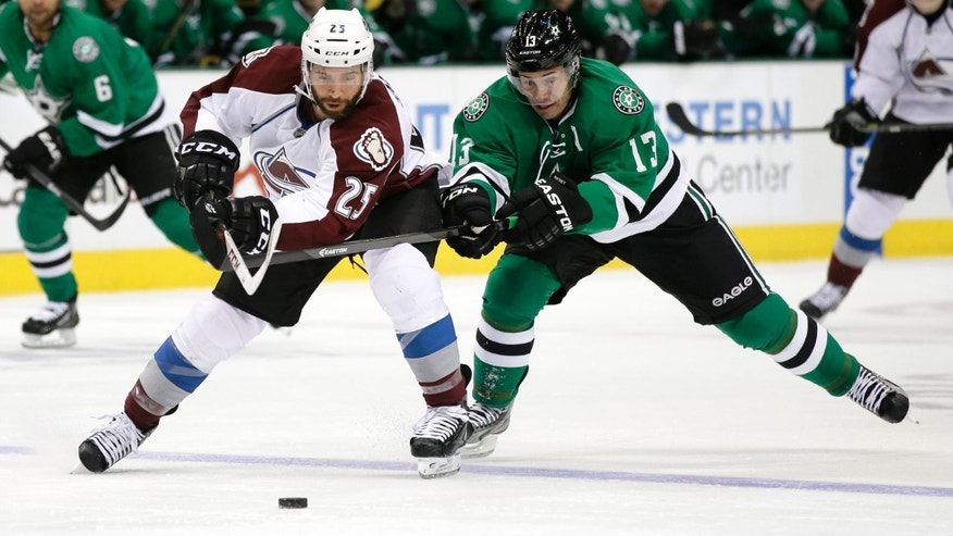 Colorado Avalanche center Maxime Talbot (25) and Dallas Stars left wing Ray Whitney (13) compete for control of a loose puck in the second period of an NHL hockey game, Friday, Nov. 1, 2013, in Dallas. (AP Photo/Tony Gutierrez)