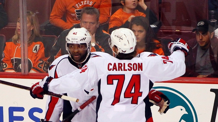 Washington Capitals' Joel Ward, left is congratulated by John Carlson after Ward scored in the second period of an NHL hockey game with the Philadelphia Flyers, Friday, Nov. 1, 2013, in Philadelphia. (AP Photo/Tom Mihalek)