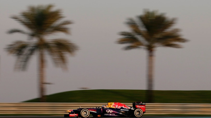 Red Bull driver Sebastian Vettel of Germany steers his car during the second free practice at the Yas Marina racetrack in Abu Dhabi, United Arab Emirates, Friday, Nov. 1, 2013. The Emirates Formula One Grand Prix will take place on Sunday. Four-time world champion Sebastian Vettel posted the fastest time in the second practice session. (AP Photo/Hassan Ammar)