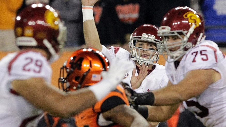 Southern California quarterback Cody Kessler passes during the first half of an NCAA college football game against Oregon State in Corvallis, Ore., Friday, Nov. 1, 2013. (AP Photo/Don Ryan)