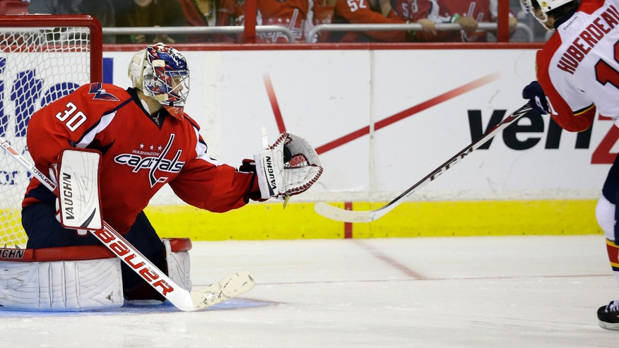 Washington Capitals goalie Michal Neuvirth (30), from the Czech Republic, catches a shot by Florida Panthers center Jonathan Huberdeau in the shootout of an NHL hockey game, Saturday, Nov. 2, 2013, in Washington. The Capitals won 3-2. (AP Photo/Alex Brandon)