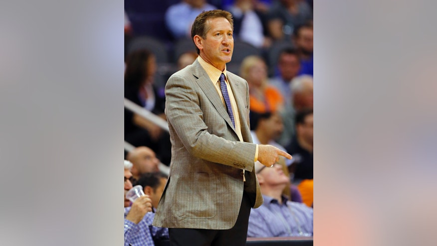 Phoenix Suns head coach Jeff Hornacek calls a play against the Utah Jazz during the first half of an NBA basketball game Friday, Nov. 1, 2013, in Phoenix. (AP Photo/Matt York)