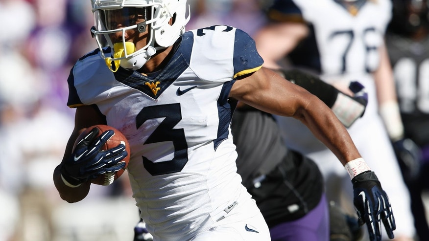 West Virginia running back Charles Sims (3) runs for a touchdown during the first half of an NCAA football game, Saturday, Nov. 2, 2013, in Fort Worth, Texas. (AP Photo/Jim Cowsert)