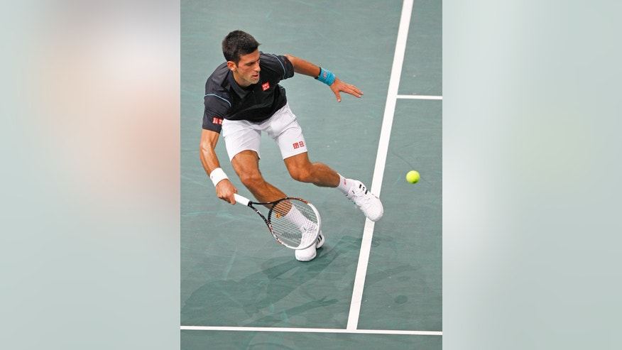 Serbia's Novak Djokovic returns the ball to Switzerland's Roger Federer during their semifinal match, at the Paris Masters tennis, in the Paris Bercy stadium, Saturday Nov. 2, 2013.(AP Photo/Remy de la Mauviniere)