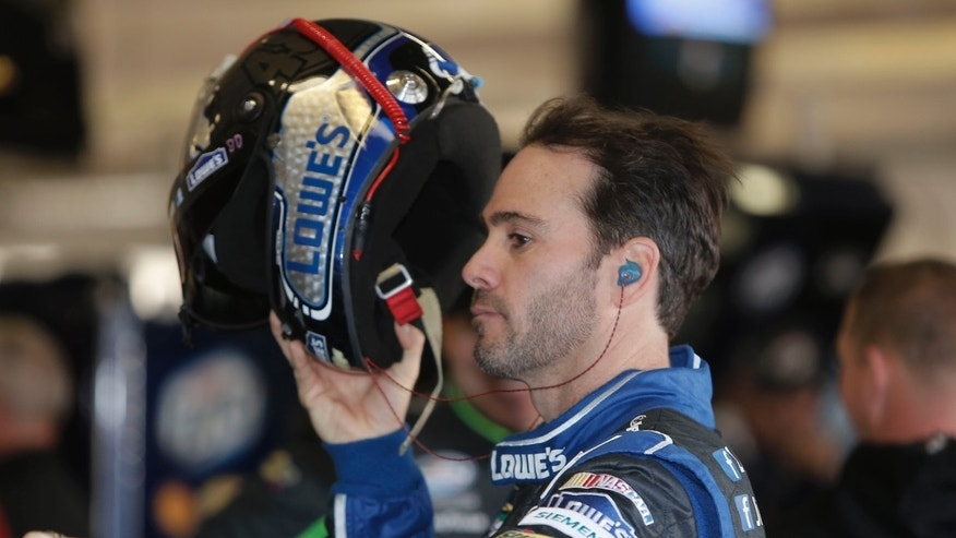 Driver Jimmie Johnson prepares for practice for Sunday's NASCAR Sprint Cup series auto race at Texas Motor Speedway in Fort Worth, Texas,  Saturday, Nov. 2, 2013.  (AP Photo/Brandon Wade)