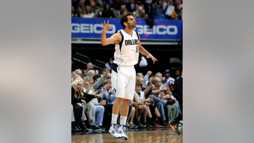 Dallas Mavericks point guard Jose Calderon, of Spain, celebrates after scoring a three-point basket in the first half of an NBA basketball game against the Memphis Grizzlies, Saturday, Nov. 2, 2013, in Dallas. (AP Photo/Tony Gutierrez)