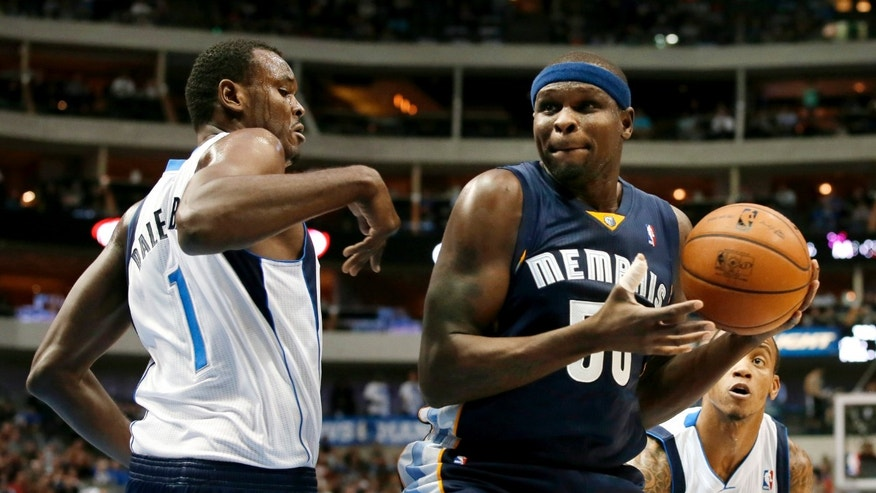 Memphis Grizzlies power forward Zach Randolph, right, works against Dallas Mavericks' Samuel Dalembert (1) of Haiti and Monta Ellis, rear, for a shot opportunity in the first half of an NBA basketball game Saturday, Nov. 2, 2013, in Dallas. (AP Photo/Tony Gutierrez)