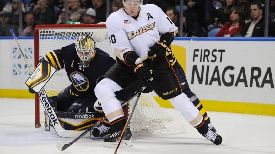 Anaheim Ducks right winger Corey Perry (10) moves the puck in front of Buffalo Sabres goaltender Jhonas Enroth (1), of Sweden, during the second period of an NHL hockey game in Buffalo, N.Y., Saturday, Nov. 2, 2013. (AP Photo/Gary Wiepert)