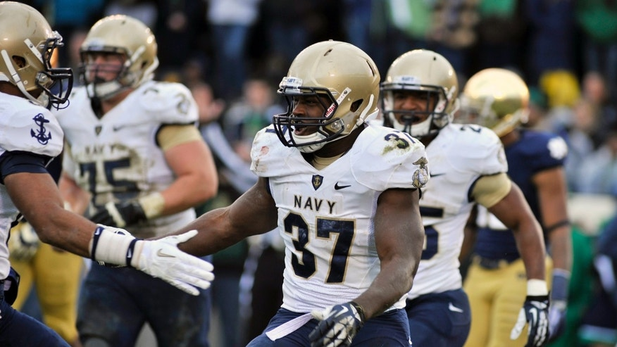 Navy's Chris Swain celebrates his touchdown against Notre Dame in the first half of an NCAA college football game, Saturday, Nov. 2, 2013, in South Bend, Ind. (AP Photo/Joe Raymond)