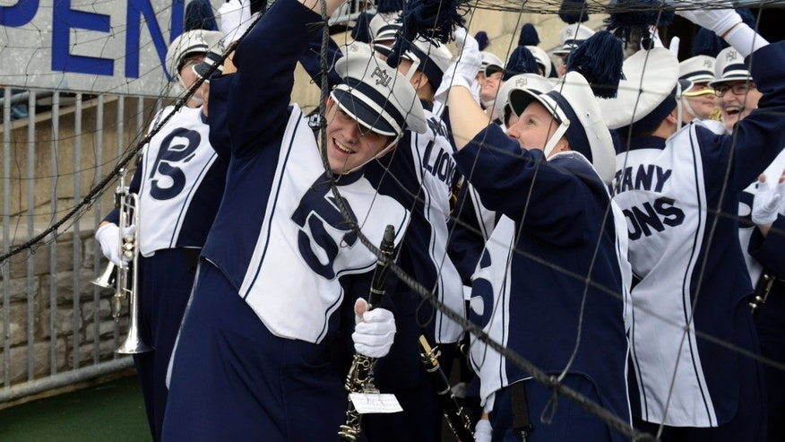 Members of Penn State's Blue Band get caught in the extra point net at Beaver Stadium before an NCAA college football game against Illinois in State College, Pa., Saturday, Nov. 2, 2013. (AP Photo/John Beale)