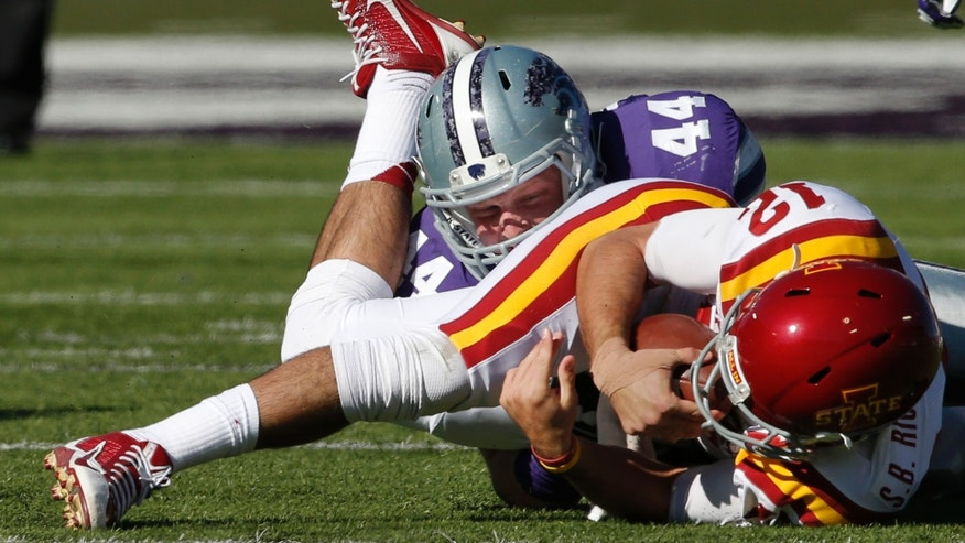 Iowa State quarterback Sam B. Richardson (12) is tackled by Kansas State defensive end Ryan Mueller (44) during the first half of an NCAA college football game at Bill Snyder Family Stadium in Manhattan, Kan., Saturday, Nov. 2, 2013. (AP Photo/Orlin Wagner)