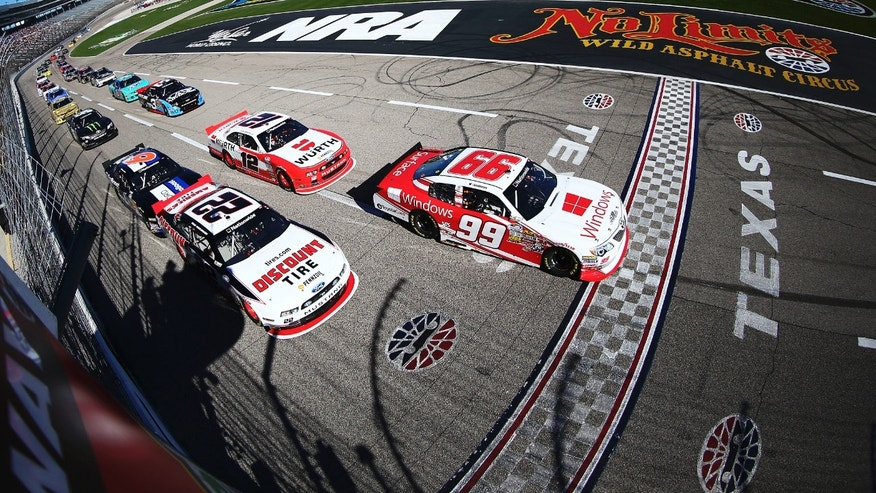In a photo provided by NASCAR, Alex Bowman (99) and Brad Keselowski (22) lead the field past the green flag to start the NASCAR Nationwide Series auto race at Texas Motor Speedway in Fort Worth, Texas, Saturday, Nov. 2, 2013. (AP Photo/NASCAR, Todd Warshaw)