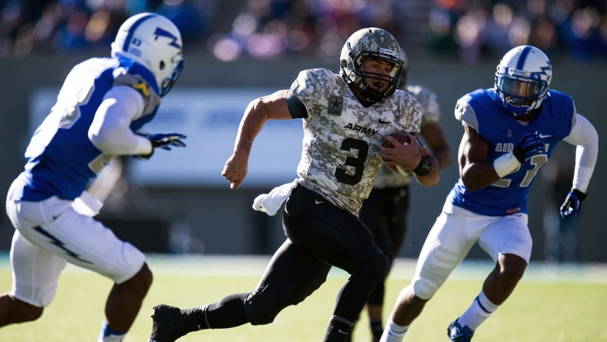 Army Black Knight quarterback Angel Santiago (3) carries the ball in the first quarter of an NCAA college football game against the Air Force Falcons in Air Force Academy, Colo. on Saturday, Nov. 2, 2013. (AP Photo/The Colorado Springs Gazette, Kent Nishimura)