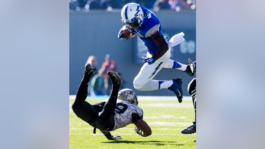 Air Force Falcon wide receiver Garrett Brown, top, leaps over Army Black Knight defensive back Josh Jenkins in the second quarter of an NCAA college football game in Air Force Academy, Colo., Saturday, Nov. 2, 2013. (AP Photo/The Colorado Springs Gazette, Kent Nishimura)