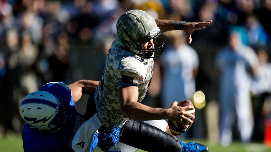 Air Force Falcon linebacker Jordan Pierce, left, sacks Army Black Knight quarterback Angel Santiago during the fourth quarter of an NCAA college football game in Air Force Academy, Colo. on Saturday, Nov. 2, 2013. The Falcons won 42-28. (AP Photo/The Colorado Springs Gazette, Kent Nishimura)