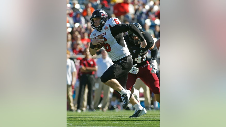 Northern Illinois quarterback Jordan Lynch (6) runs for a touchdown against Massachusetts during the first half of an NCAA football game in Foxborough, Mass., Saturday, Nov. 2, 2013. (AP Photo/Stew Milne)