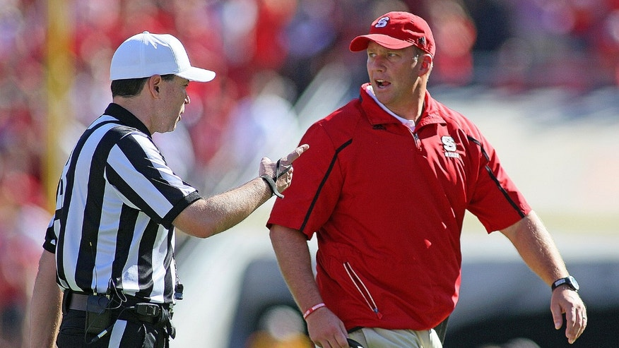 North Carolina State head coach Dave Doeren protest a call with an official during the first half of an NCAA college football game against North Carolina in Raleigh , N.C., Saturday, Nov. 2, 2013. (AP Photo/Karl B DeBlaker)