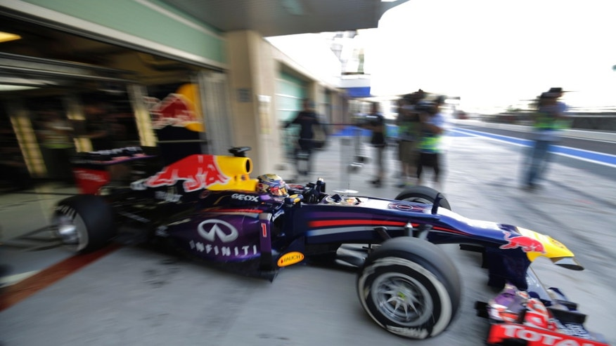 Red Bull driver Sebastian Vettel of Germany steers his car leaving pits during the third free practice at the Yas Marina racetrack in Abu Dhabi, United Arab Emirates, Saturday, Nov. 2, 2013. The Emirates Formula One Grand Prix will take place on Sunday. (AP Photo/Hassan Ammar)