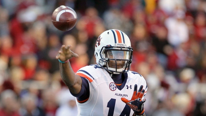 Auburn quarterback Nick Marshall passes during the first half of an NCAA college football game against Arkansas in Fayetteville, Ark., Saturday, Nov. 2, 2013. (AP Photo/Danny Johnston)