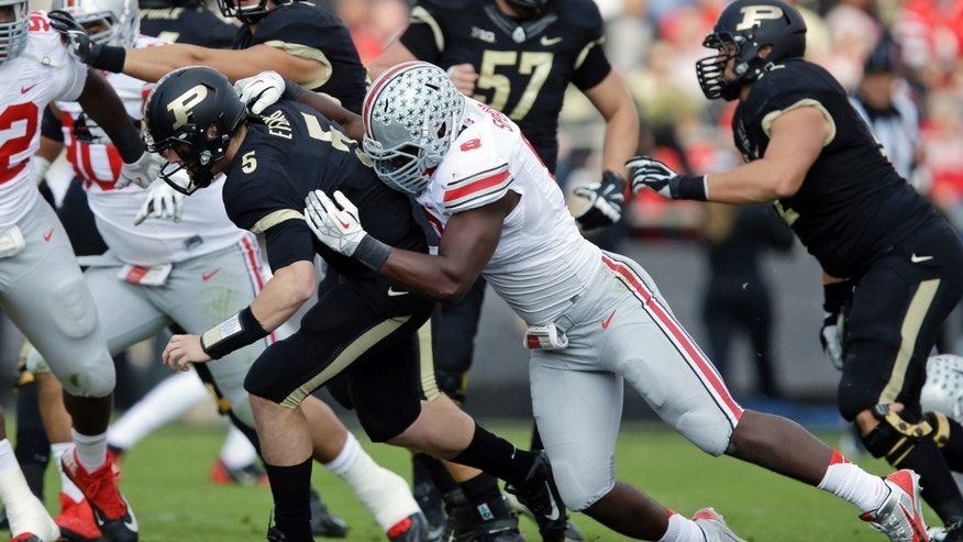 Ohio State defensive lineman Noah Spence, right, sacks Purdue quarterback Danny Etling during the first half of an NCAA college football game in West Lafayette, Ind., Saturday, Nov. 2, 2013. (AP Photo/Michael Conroy)