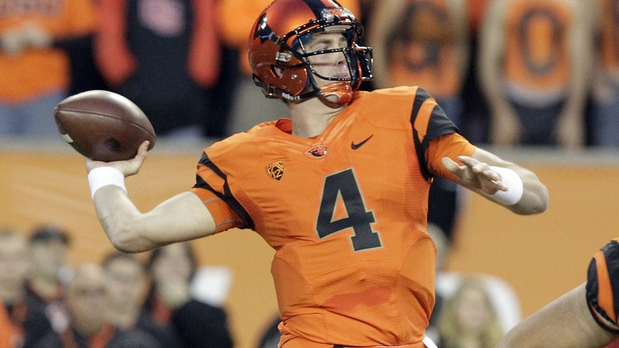 Oregon State quarterback Sean Mannion passes during the first half of an NCAA college football game against Southern California in Corvallis, Ore., Friday, Nov. 1, 2013. (AP Photo/Don Ryan)