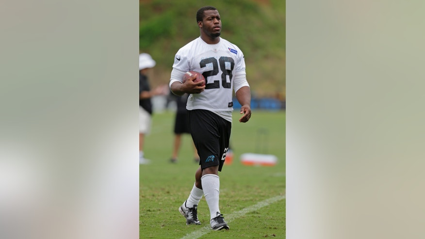 In this Aug. 7, 2013 photo, Carolina Panthers running back Jonathan Stewart (28) walks down the field with the ball during an NFL football training camp practice in Spartanburg, N.C. The Panthers remain hopeful that  Stewart, who has missed the first seven games of the season recovering from ankle surgery, will return to action this Sunday, nov. 3, 2013, against Atlanta.(AP Photo/Chuck Burton)