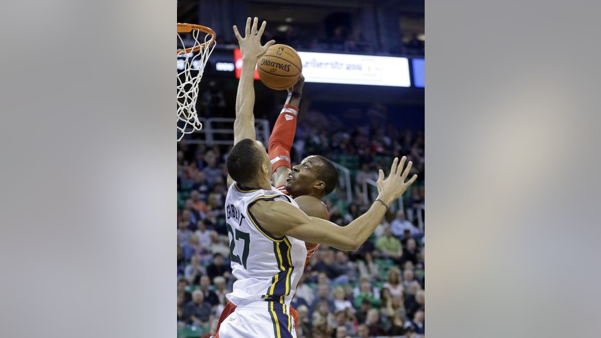 Houston Rockets' Dwight Howard, right, goes to the basket as Utah Jazz's Rudy Gobert (27), of France, defends in the first quarter during an NBA basketball game Saturday, Nov. 2, 2013, in Salt Lake City.  (AP Photo/Rick Bowmer)