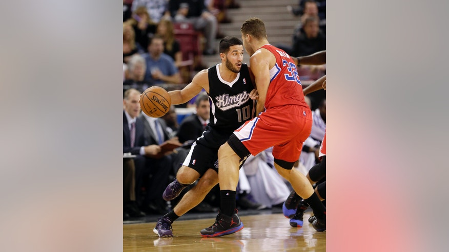 Sacramento Kings guard Greivis Vasquez, of Venezuela, left, drives against Los Angeles Clippers forward Blake Griffin during the first quarter of an NBA basketball game in Sacramento, Calif., Friday, Nov. 1, 2013. (AP Photo/Rich Pedroncelli)
