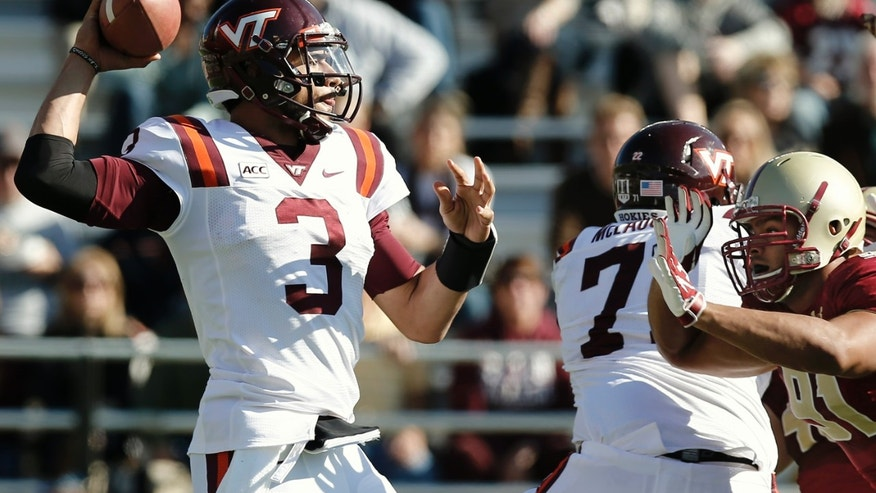 Virginia Tech quarterback Logan Thomas throws down field against the rush from Boston College's Kasim Edebali (91) during the first half of an NCAA college football game at Alumni Stadium in Boston, Saturday, Nov. 2, 2013. (AP Photo/Winslow Townson)