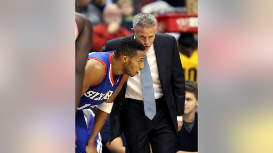 Philadelphia 76ers' Brett Brown, right talks to Evan Turner as they play the Chicago Bulls in the first half of an NBA basketball game Saturday, Nov. 2, 2013, in Philadelphia.  (AP Photo/H. Rumph Jr)