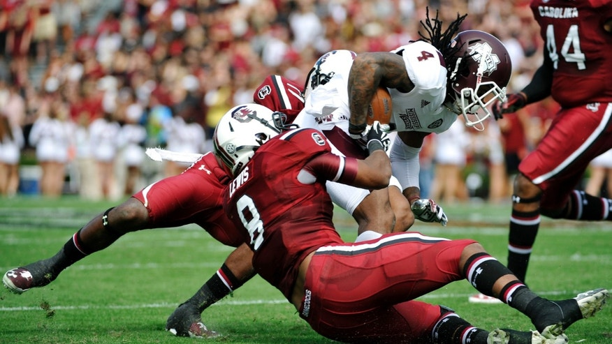 Mississippi State wide receiver Jameon Lewis (4) is tackled by South Carolina linebacker Kaiwan Lewis (8) during the first half of an NCAA college football game, Saturday, Nov. 2, 2013, in Columbia, S.C. (AP Photo/Rainier Ehrhardt)