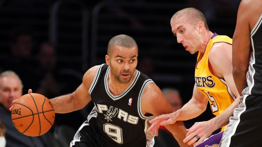 San Antonio Spurs guard Tony Parker, left, of France, dribbles around Los Angeles Lakers' Steve Blake in the first quarter during an NBA basketball game Friday, Nov. 1, 2013, in Los Angeles. (AP Photo/Alex Gallardo)