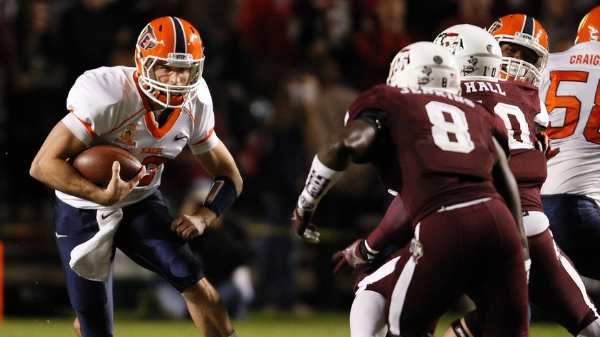 UTEP's Blaire Sullivan, left, runs the ball as Texas A&M's Steven Jenkins (8) defends during the first half of an NCAA football game, Saturday, Nov. 2, 2013 in College Station,Texas. (AP Photo/Eric Christian Smith)