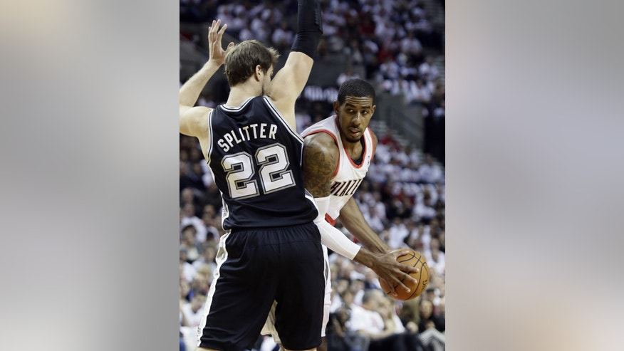 Portland Trail Blazers forward LaMarcus Aldridge, right, looks for room to maneuver against San Antonio Spurs forward Tiago Splitter, from Brazil, during the first half of an NBA basketball game in Portland, Ore., Saturday, Nov. 2, 2013. (AP Photo/Don Ryan)