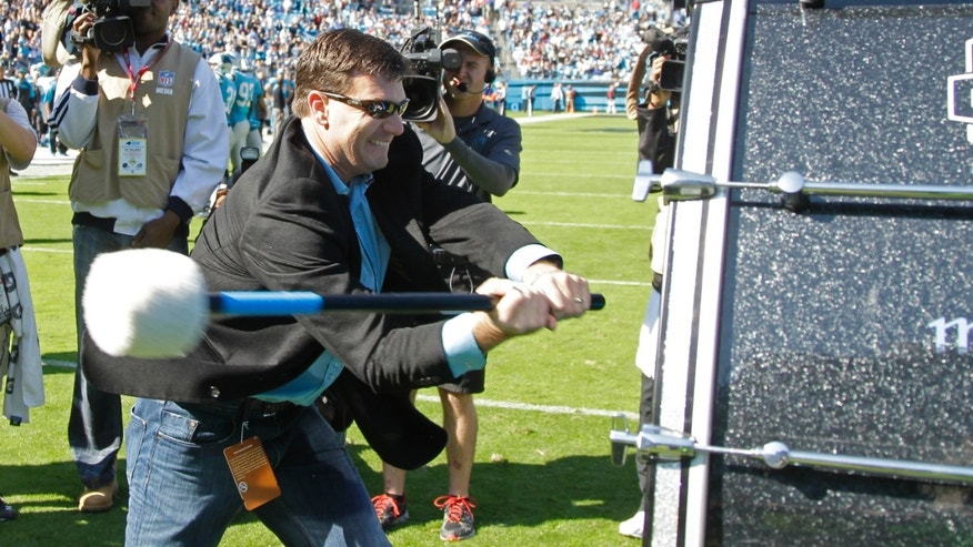 Former Carolina Panthers quarterback Jake Delhomme pounds a drum before an NFL football game against the Atlanta Falcons in Charlotte, N.C., Sunday, Nov. 3, 2013. (AP Photo/Bob Leverone)