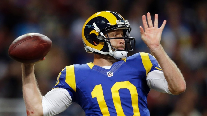 St. Louis Rams quarterback Kellen Clemens throws during the fourth quarter of an NFL football game against the Tennessee Titans Sunday, Nov. 3, 2013, in St. Louis. (AP Photo/Jeff Roberson)