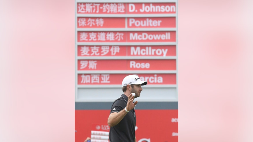Dustin Johnson of the United States acknowledges the crowd on the 8th green during the final round of the HSBC Champions golf tournament at the Sheshan International Golf Club in Shanghai, China, Sunday, Nov. 3, 2013. (AP Photo/Eugene Hoshiko)