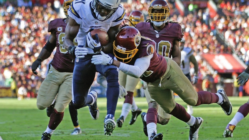 San Diego Chargers wide receiver Eddie Royal breaks a tackle from Washington Redskins strong safety Brandon Meriweather to score a touchdown during the first half of a NFL football game in Landover, Md., Sunday, Nov. 3, 2013. (AP Photo/Patrick Semansky)