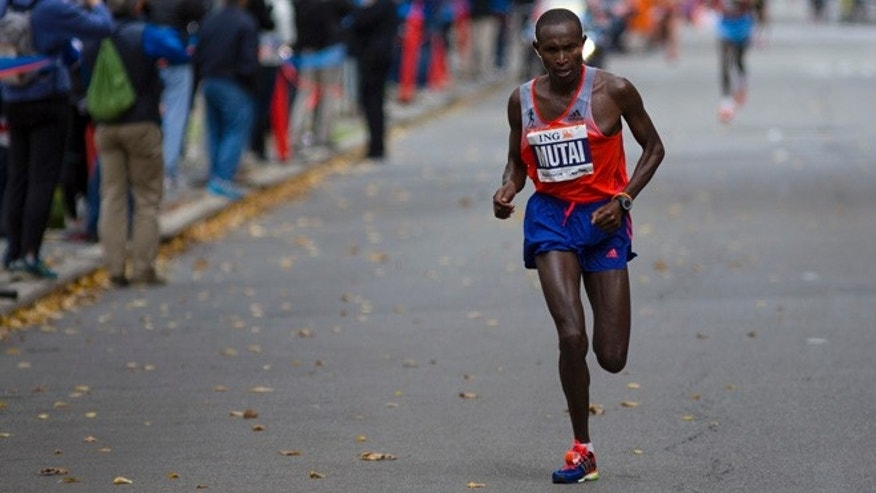 Nov. 3, 2013: Geoffrey Mutai of Kenya runs along Fifth Avenue in New York during the New York Marathon. In a double victory for Kenya, Mutai has successfully defended his title and Priscah Jeptoo rallied to win the women's race.