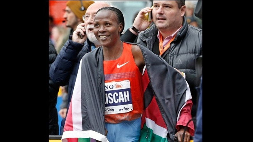 Nov. 3, 2013: Women's winner Priscah Jeptoo of Kenya reacts with members of her team after coming in first in the women's division of the New York City Marathon in New York.